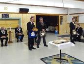 VW Bro. Gaul of Alexandra Lodge receives the Traveling Gavel from W Bro. Allan Chapman of Acacia Lodge.
